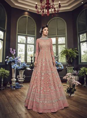 Add This Beautiful Heavy Designer Floor Length Suit In Pink Color Paired With Pink Colored Bottom And dupatta. Its Top And Dupatta Are Net Fabricated Paired With Art Silk Bottom. Also Its Top Is Beautified With Heavy Embroidery All Over.