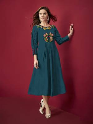 Grab This Beautiful Designer Readymade Kurti In Blue Color Fabricated on Rayon. It Is Beautified With Resham Work And Available In All Regular Sizes.