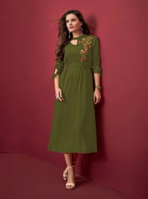 Trending Color Of The Season Is Here With This Designer Readymade Kurti In Olive Green Color Fabricated On Rayon. It Has Lovely Patterned Sleeves With Embroidered Yoke.