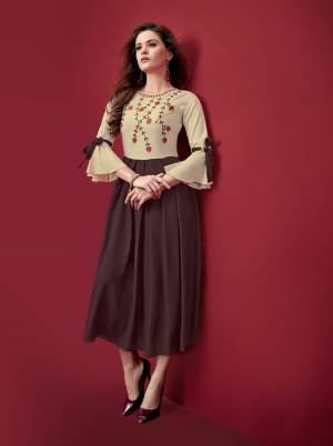 Simple And Elegant Looking Designer Readymade Kurti Is Here In Brown And Cream Color Fabricated On Rayon. Its Fabric Is Soft Towards Skin And Easy To Carry All Day Long.