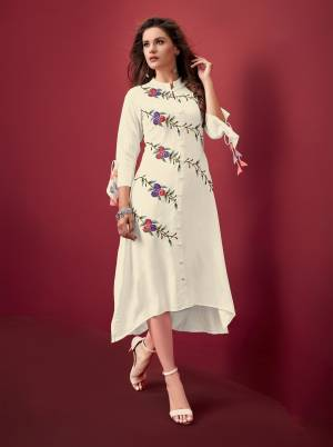 Add This Lovely Designer Readymade Kurti In White Color Fabricated On Rayon. It Is Light In Weight, Easy To Carry And Durable.