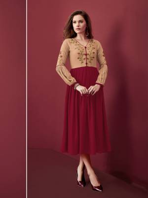 Look Pretty In This Designer Readymade Kurti In Maroon And Beige Color Fabricated On Rayon. It Is Beautified With Resham Embroidery Over The Yoke.