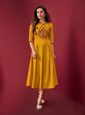 For Your Semi-Casuals, Grab This Pretty Readymade Kurti In Yellow Color Fabricated On Rayon. It Is Beautified With Resham Work. Buy Now.