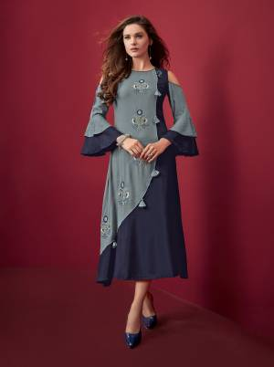 Pretty Shades Of Blue Are Here With This Designer Readymade Kurti In Navy Blue And Light Blue color Fabricated On Rayon. It Is Available In All Regular Sizes. Buy Now.