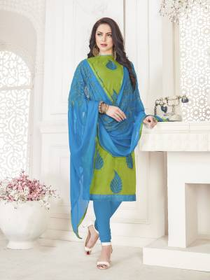 Cool Color Pallete Is Here With This Dress Material In Green Colored Top Paired With Contrasting Turquoise Blue Colored Bottom And Dupatta. Its Top And Bottom Are Cotton Based Paired With Chiffon Dupatta. Its Fabric Ensures Superb Comfort All Day Long.