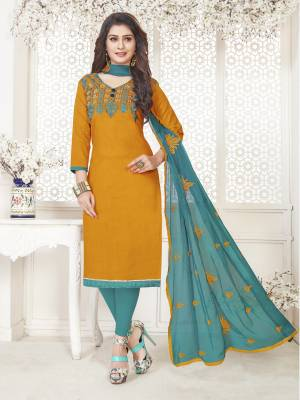 For Youe Semi-Casuals, Grab This Pretty Dress Material In Musturd Yellow Colored Top Paired With Contrasting Turquoise Blue Colored Bottom And Dupatta. Ithis Dress Material In Cotton Based Paired With Chiffon Dupatta. Buy Now.