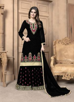 This Festive Season, Adorn A Lovely Look Wearing This Designer Sharara Suit In Black Color. Its Top And Bottom Are Georgette Based Paired With Chiffon Dupatta. Its Top And Bottom Are Beautified With Heavy Embroidery. Buy Now.