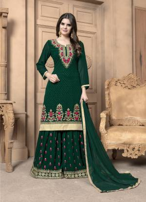 This Festive Season, Adorn A Lovely Look Wearing This Designer Sharara Suit In Pine Green Color. Its Top And Bottom Are Georgette Based Paired With Chiffon Dupatta. Its Top And Bottom Are Beautified With Heavy Embroidery. Buy Now.
