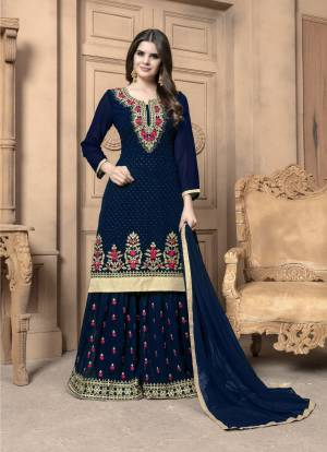 This Festive Season, Adorn A Lovely Look Wearing This Designer Sharara Suit In Navy Blue Color. Its Top And Bottom Are Georgette Based Paired With Chiffon Dupatta. Its Top And Bottom Are Beautified With Heavy Embroidery. Buy Now.
