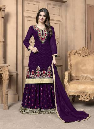This Festive Season, Adorn A Lovely Look Wearing This Designer Sharara Suit In Purple Color. Its Top And Bottom Are Georgette Based Paired With Chiffon Dupatta. Its Top And Bottom Are Beautified With Heavy Embroidery. Buy Now.