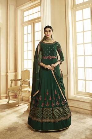 Grab This Very Pretty, Designer Floor Length Suit In Dark Green Color. This Pretty Suit Is Georgette Based Paired With Santoon Bottom And Georgette Dupatta. It Is Beautified With Attractive Embroidery.