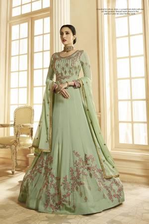 This Season Is About Subtle Shades And Pastel Play, So Grab This Designer Floor Length Suit In Pastel Green Color Paired With Pastel Green Colored Bottom And Dupatta. It Is Georgette Based Beautified With Heavy Embroidery. Buy This Semi-Stitched Suit Now.
