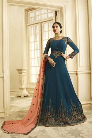 Add This Rich Looking Designer Floor Length Suit To Your Wardrobe In Blue Color Paired With Contrasting Peach Colored Dupatta. This Suit Is Fabricated On Georgette Paired With Santoon Bottom And Georgette Dupatta.