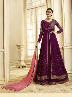 Must Have Shade In Every Womens Wardrobe Is Here With This Designer Floor Length Suit In Wine Color Paired With Contrasting Pink Colored Dupatta. This Suit Is Fabricated On Georgette Paired With Santoon Bottom And Georgette Buy Now.
