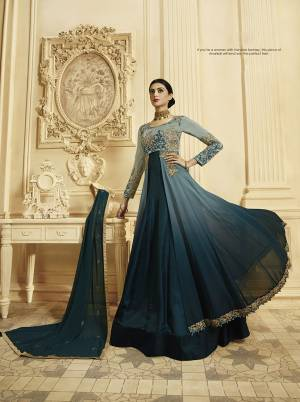 Here Is A Lovely Designer Floor Length Suit In Shades Of Blue, Grab This Designer Floor Length Suit In Steel Blue And Prussian Blue Color Paired With Prussian Blue Colored Bottom And Dupatta. Iit Is Georgette Based Beautified With Heavy Attractive Embroidery.