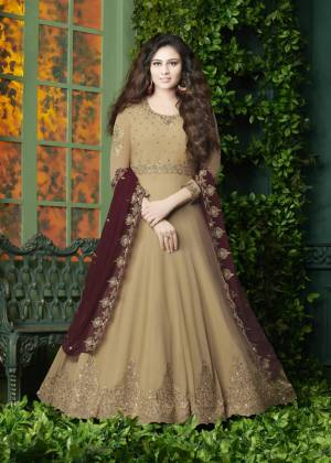 Flaunt Your Rich And Elegant Look Wearing This Designer Floor Length Suit In Beige Color Paired With Beige Colored Bottom And Maroon Colored Dupatta. It Top Is Fabricated On Georgette Paired With Santoon Bottom And Georgette Dupatta. It Has Very Pretty Embroidery over The Top And Dupatta. Buy Now.