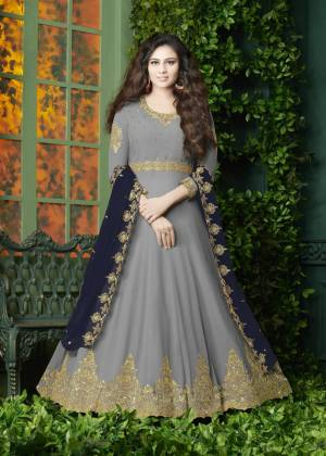 Flaunt Your Rich And Elegant Look Wearing This Designer Floor Length Suit In Grey Color Paired With Grey Colored Bottom And Navy Blue Colored Dupatta. It Top Is Fabricated On Georgette Paired With Santoon Bottom And Georgette Dupatta. It Has Very Pretty Embroidery over The Top And Dupatta. Buy Now.