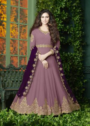 Flaunt Your Rich And Elegant Look Wearing This Designer Floor Length Suit In Pink Color Paired With Pink Colored Bottom And Dark Purple Colored Dupatta. It Top Is Fabricated On Georgette Paired With Santoon Bottom And Georgette Dupatta. It Has Very Pretty Embroidery over The Top And Dupatta. Buy Now.