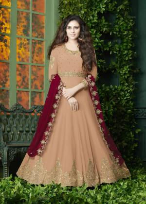 Flaunt Your Rich And Elegant Look Wearing This Designer Floor Length Suit In Peach Color Paired With Peach Colored Bottom And Red Colored Dupatta. It Top Is Fabricated On Georgette Paired With Santoon Bottom And Georgette Dupatta. It Has Very Pretty Embroidery over The Top And Dupatta. Buy Now.