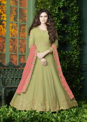 Flaunt Your Rich And Elegant Look Wearing This Designer Floor Length Suit In Light Green Color Paired With Light Green Colored Bottom And Peach Colored Dupatta. It Top Is Fabricated On Georgette Paired With Santoon Bottom And Georgette Dupatta. It Has Very Pretty Embroidery over The Top And Dupatta. Buy Now.