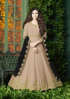 Flaunt Your Rich And Elegant Look Wearing This Designer Floor Length Suit In Beige Color Paired With Beige Colored Bottom And Black Colored Dupatta. It Top Is Fabricated On Georgette Paired With Santoon Bottom And Georgette Dupatta. It Has Very Pretty Embroidery over The Top And Dupatta. Buy Now.