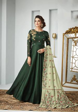 Go With The Shades Of Green With This Designer Floor Length Suit In Dark Green Color Paired With Pastel Green Colored Dupatta, Its Top Is Fabricated On Satin Georgette Paired With Santoon Bottom And Art Silk Dupatta. It Is Light In Weight And Easy To Carry All Day Long.