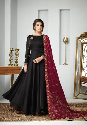 For A Bold And Beautiful Look, Grab This Designer Floor Length Suit In Black Color paired with Maroon Colored Dupatta. Its Top Is Fabricated On Satin Georgette Paired With Santoon Bottom And Art Silk Dupatta. All Its Fabric Are Soft Towards Skin And Ensures Superb Comfort All Day Long.