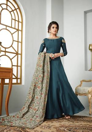 New Shade Is Here To Add Into Your Wardrobe With This Designer Floor Length Suit In Prussian Blue Color Paired With Contrasting Grey Colored Dupatta. Its Top Is Fabricated On Satin Georgette Paired With Santoon Bottom and Art Silk Dupatta. Buy Now.