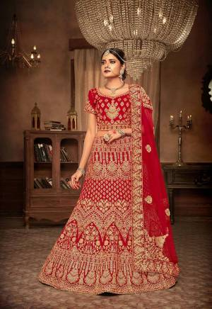 Get Ready For Your Big Day With This Heavy Designer Lehenga Choli In Red Color. This Heavy Embroidered Lehenga Choli Is Fabricated On Velvet Paired With Net Fabricated Dupatta. It Is Beautified With Heavy Jari & Thread Embroidery and Stone Work. Buy Now