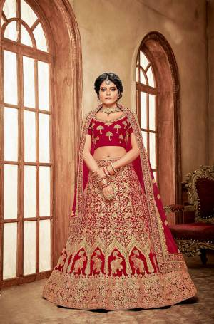 Here Is A Perfect Bridal Look For You With This Heavy designer Lehenga Choli In Red Color. This Lehenga Choli Is Velvet Based Paired With Net Fabricated Dupatta.Its Fabric Also Ensures Superb Comfort Throughout The Gala