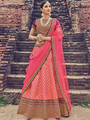 Wear This Pink Colored rich jacquard Silk Lehenga Ideal for party, festive & social gatherings. this gorgeous saree featuring a beautiful mix of designs. Its attractive color and jacquard lehenga with net fabrics work over the attire & contrast hemline adds to the look. Comes along with a contrast unstitched blouse.