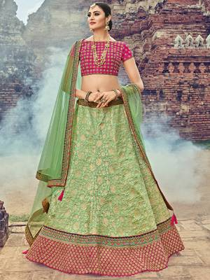 Bring out the best in you when wearing this Light green color Jacquard Silk Fabricated Lehenga. Ideal for party, festive & social gatherings. this gorgeous saree featuring a beautiful mix of designs. Its attractive color and jacquard lehenga with net fabrics work over the attire & contrast hemline adds to the look. Comes along with a contrast unstitched blouse.
