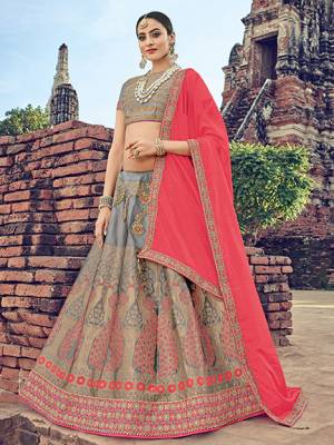 The fabulous pattern makes this a classy number to be included in your wardrobe. pink and grey color. Ideal for party, festive & social gatherings. this gorgeous saree featuring a beautiful mix of designs. Its attractive color and jacquard lehenga with chinon fabrics work over the attire & contrast hemline adds to the look. Comes along with a contrast unstitched blouse.