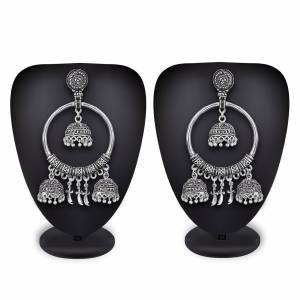 Grab This Rich and Elegant Looking Set Of Earrings In Silver Color Which Can Be Paired With Any colored Attire. It Is Light In Weight And Easy To Carry All Day Long.