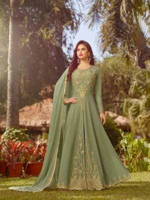 This Season Is About Subtle Shades And Pastel Play, So Grab This Heavy Designer Floor Length Suit In Pastel Green Color. Its Top And Dupatta Are Georgette Based Paired With Santoon Bottom.