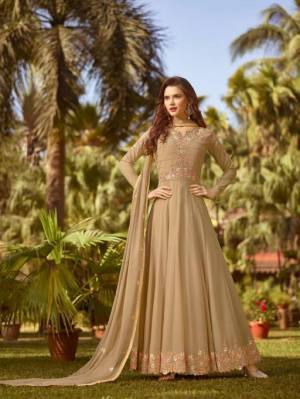 Flaunt Your Rich And Elegant Taste In This Designer Floor Length Suit In Beige Color. This Pretty Suit Is Georgette Based Beautified with Jari And Thread Work. Buy This Suit Now.