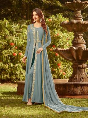 Celebrate This Festive Season With Rich Color And Fabric Wearing This Designer Floor Length Suit In Steel Blue Color. Its Top And Dupatta Are Fabricated On Georgette Paired With Santoon Bottom. Buy Now.