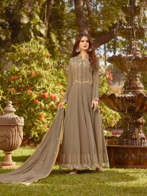 Add This New Shade To Your Wardrobe With This Designer Floor Length Suit In Sand Grey Color Paired With Sand Grey Colored Bottom And Dupatta.  This Designer Suit Is Georgette Based Beautified With Embroidery.
