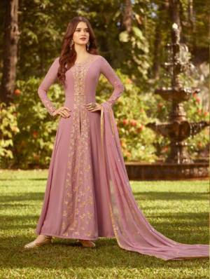 Look Pretty In This Designer Floor Length Suit In Light Pink Color Paired With Light Pink Colored Bottom And Dupatta. Its Top And Dupatta Are Fabricated On Georgette paired With Santoon Bottom. Buy This Now.