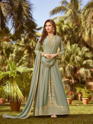 This Season Is About Subtle Shades And Pastel Play, So Grab This Heavy Designer Floor Length Suit In Mint Green Color. Its Top And Dupatta Are Georgette Based Paired With Santoon Bottom.