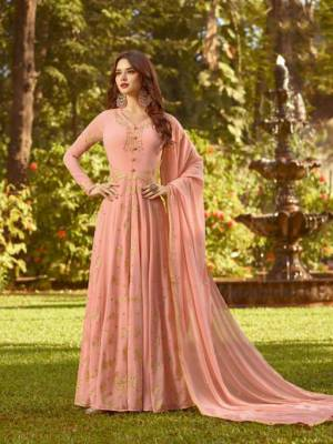 Flaunt Your Rich And Elegant Taste In This Designer Floor Length Suit In Peach Color. This Pretty Suit Is Georgette Based Beautified with Jari And Thread Work. Buy This Suit Now.