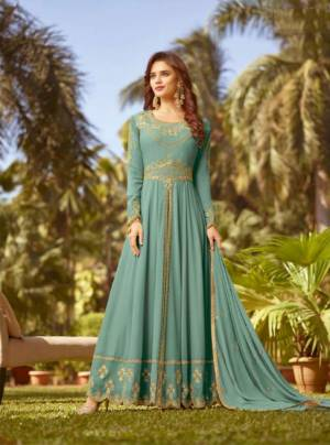 Celebrate This Festive Season With Rich Color And Fabric Wearing This Designer Floor Length Suit In Turquoise Blue Color. Its Top And Dupatta Are Fabricated On Georgette Paired With Santoon Bottom. Buy Now.