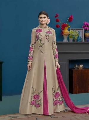 Flaunt Your Rich And Elegant Taste Wearing This Designer Indo Western Suit In Beige Colored Top Paired With Dark Pink Colored Lehenga And Dupatta. Its Top And Lehenga Are Silk Based Paired With Chiffon Dupatta.
