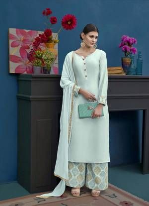 Rich And Elegant Looking Designer Straight Plazzo Suit Is Here In Very Pretty Shade Of Blue That Is Aqua Blue. Its Top And Bottom Are Silk Based Paired With Chiffon Dupatta. Buy Now.