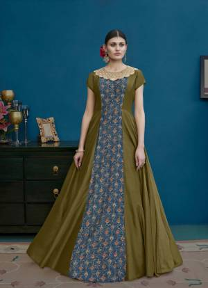 Another Designer Floor Length Suit Is Here In Olive Green And Blue Color Paired With Olive Green Colored Bottom And Dupatta. Its Top Is Fabricated On Art Silk Paired With Santoon Bottom And Chiffon Dupatta. Buy Now.