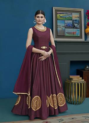 You Will Definitely Earn Lots Of Complimets Wearing This Rich And Elegant Looking Designer Floor Length Suit In Wine Color. Its Top Is Fabricated On Art Silk Paired With Santoon Bottom And Chiffon. Its Color And Fabric Will Give A Rich Look To Your Personality.