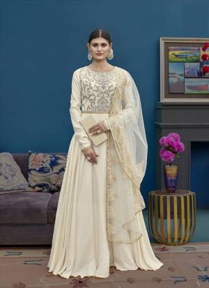 Simple And Elegant Looking Designer Floor Length  Suit Is Here In Cream Color. Its Top Is Fabricated On Art Silk Paired With Santoon Bottom And Net Fabricated Dupatta. Buy This Now.