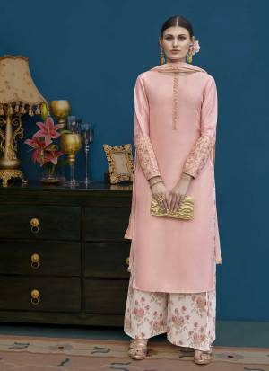 Look Very Pretty In This Designer Plazzo Suit In Light Pink Color Paired With Baby Pink Colored Bottom. This Lovely Suit Is Art Silk Based Paired With Chiffon Dupatta. Its Subtle Color And Rich Fabric Will Earn You Lots Of Compliments From Onlookers.
