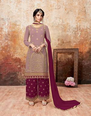 Grab This Beautiful Designer Plazzo Suit With Lovely Color Pallete. Iits top Is In Mauve Color Paired With Magenta Pink Colored Bottom And Dupatta. Its Top And Bottom Are Georgette Based Paired With Chiffon Dupatta. Buy This Semi-Stitched Suit Now.