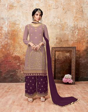 Grab This Beautiful Designer Plazzo Suit With Lovely Color Pallete. Iits top Is In Mauve Color Paired With Purple Colored Bottom And Dupatta. Its Top And Bottom Are Georgette Based Paired With Chiffon Dupatta. Buy This Semi-Stitched Suit Now.